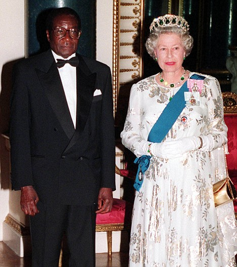 File photo dated 17/5/94 of Queen Elizabeth II with Zimbabwe's President Robert Mugabe, before a State Banquet at Buckingham Palace. See PA story POLITICS Zimbabwe Factfile. PA Photo: John Stillwell