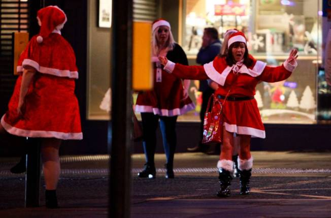 Women dressed as Mrs Claus get into the party spirit on black eye Friday in Newcastle. December 18 2015. See SWNS story SWPARTY.