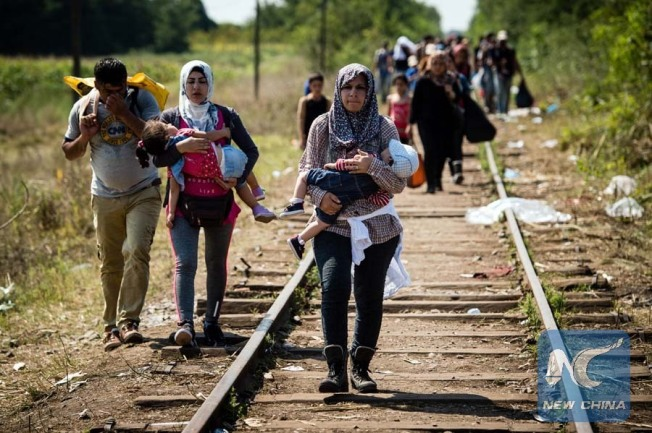 [ObjectName]=SERBIA-HUNGARY-EU-MIGRANTS [Urgency]=5 [Category]=SOI [DateCreated]=120324+0000 [OriginalTransmissionReference]=AFP Reporter [Byline]=AFP [City]=HORGOS [CountryCode]=SRB [CountryName]=SERBIA OriginalTransmissionReference]=AND002 [Credit]=AFP [Source]=AFP [Caption]=Migrants and refugees walk down railroad track towards the Hungarian border near the northern Serbian town of Horgos on August 27, 2015. As Hungary scrambles to ramp up defences on its border with Serbia, refugees continued to surge into the country in record numbers, police figures confirmed. AFP PHOTO / ANDREJ ISAKOVIC [CaptionWriter]=ai/vel
