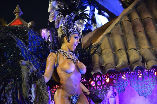 A reveler of the Grande Rio samba school performs during the first night of carnival parade at the Sambadrome in Rio de Janeiro on March 2, 2014.  AFP PHOTO / CHRISTOPHE SIMON