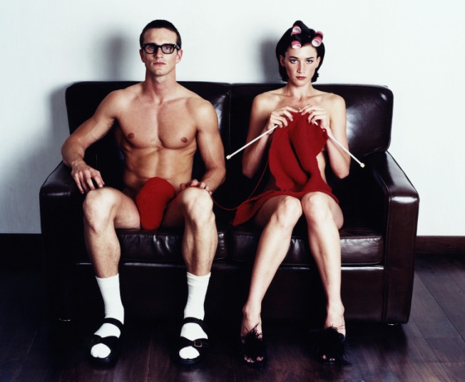 Naked couple sitting on couch, woman knitting, portrait  Creativ