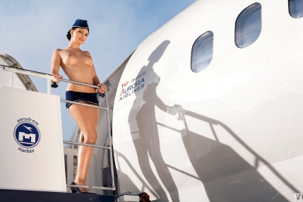andreja-karba-naked-air-stewardess-stripping-out-of-her-uniform-on-an-airplane-for-playboy-www-gutteruncensored-com-002