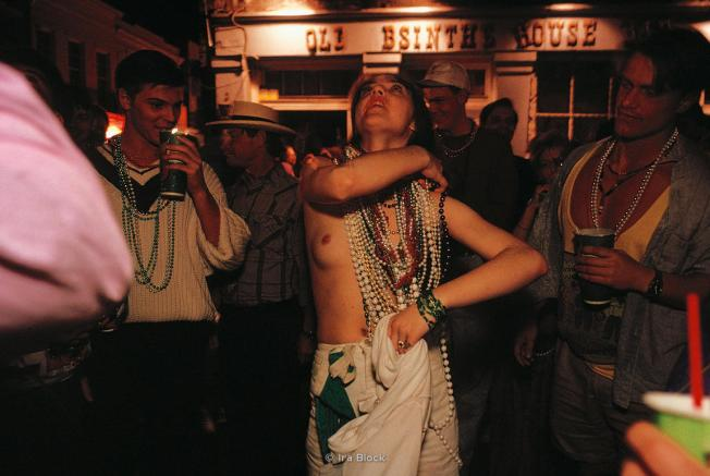 Woman flashes her breasts for beads at Mardi Gras, New Orleans, Louisiana.