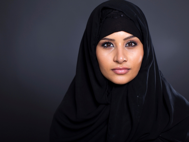 attractive Muslim woman on black background